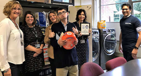 educators join student and parent at new laundry facility