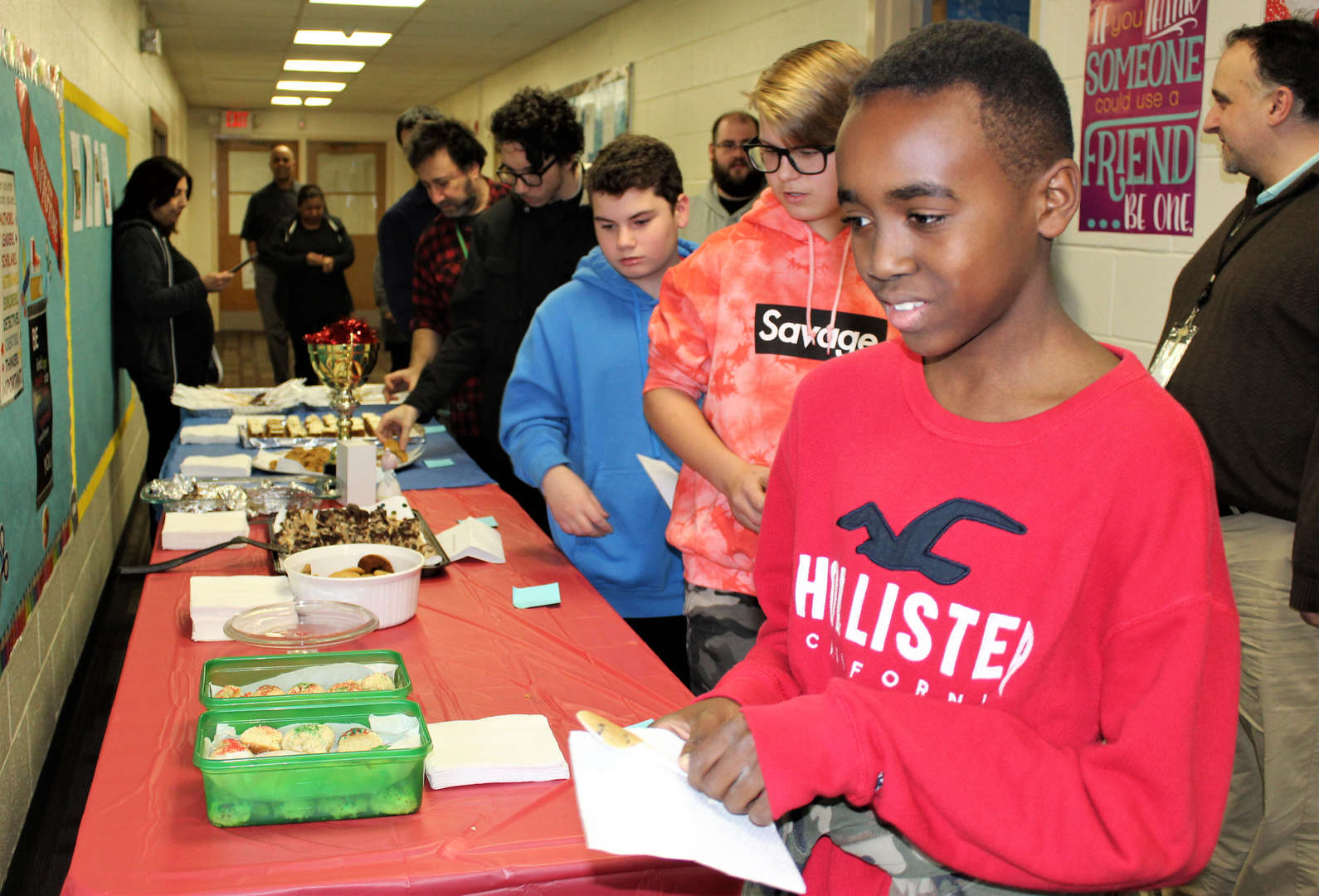 Rye Lake students pick up samples of all the entries in the Cookie Bake Off.