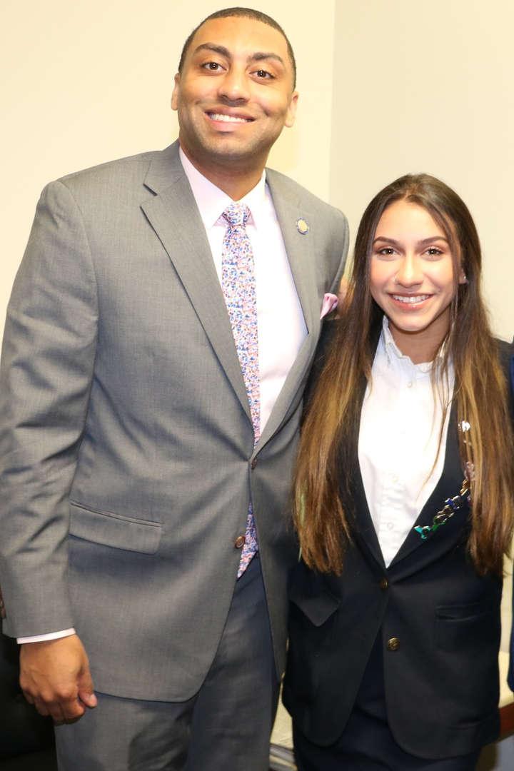 Student and legislator pose