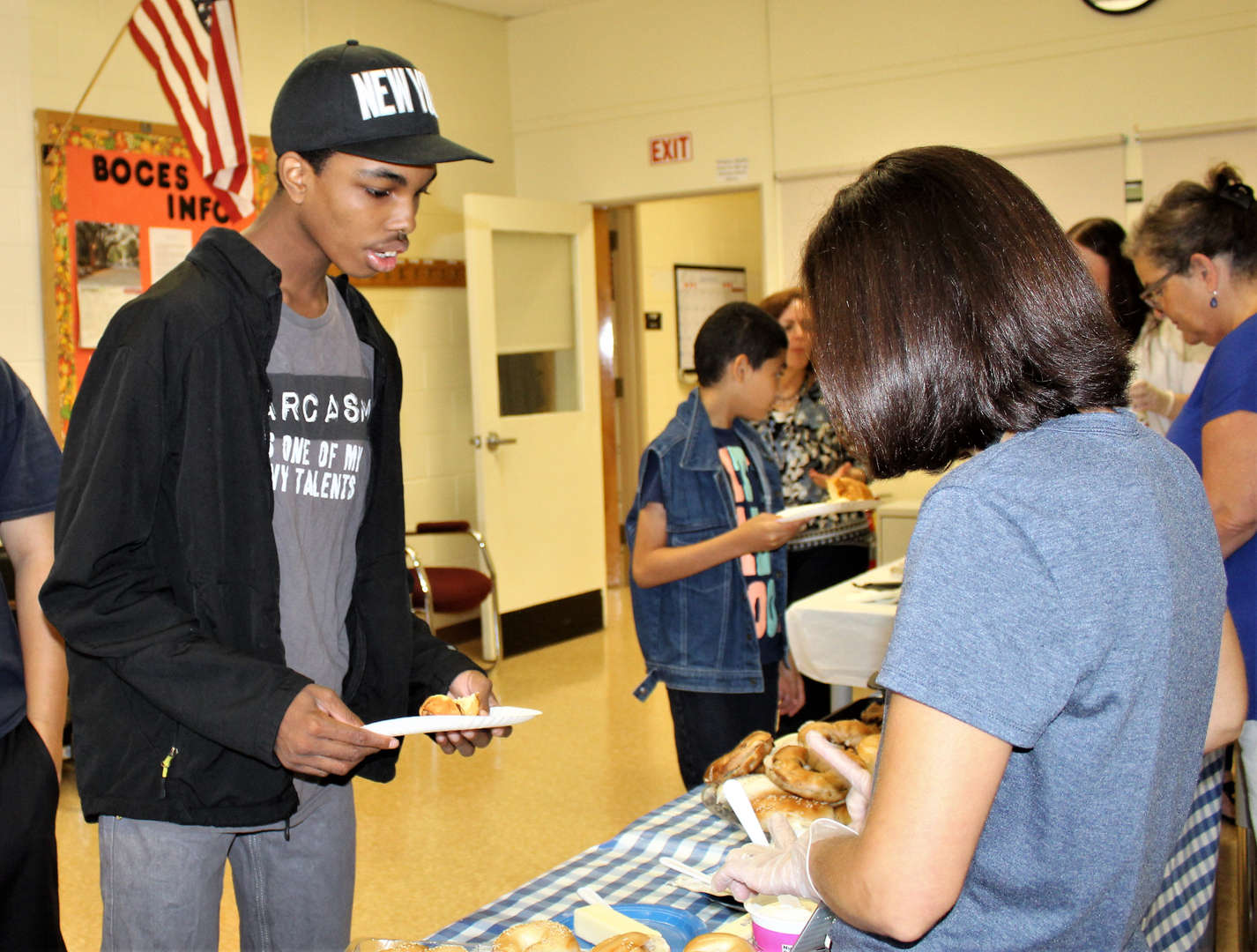 A student selects food from the buffet at the Spirit Week breakfast.