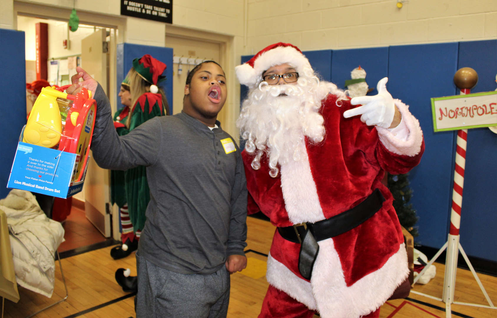 Student poses with Santa at a holiday party.