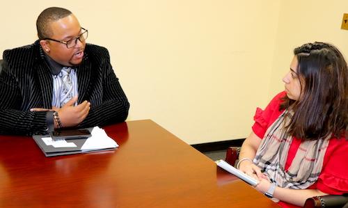 graduate speaking with legislative aide