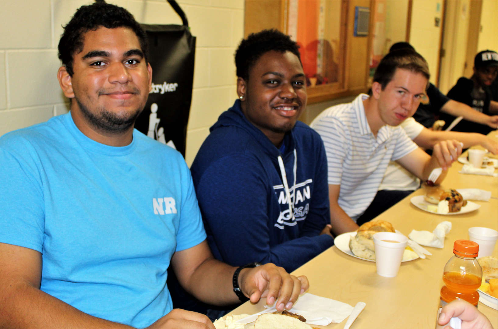 Students pose for photo during Spirit Week breakfast