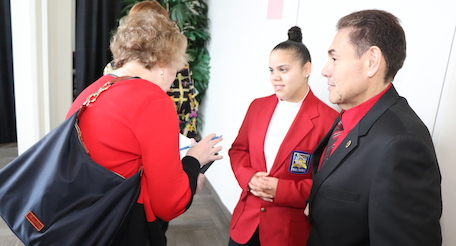 reporter interviewing student and teacher
