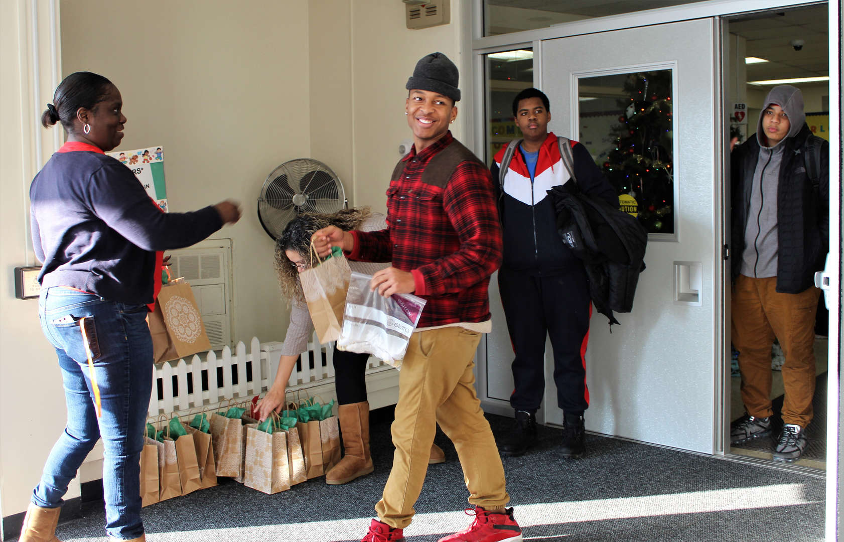 A male student receives a gift bag as he leaves Rye Lake for the day.
