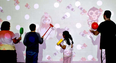 students manipulating an interactive wall in class