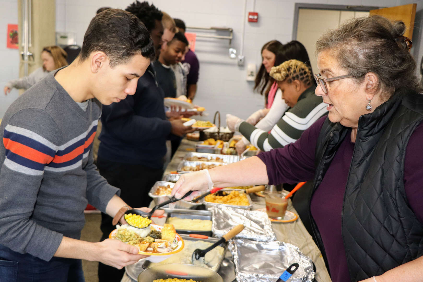 staff members served up Thanksgiving fare at luncheon