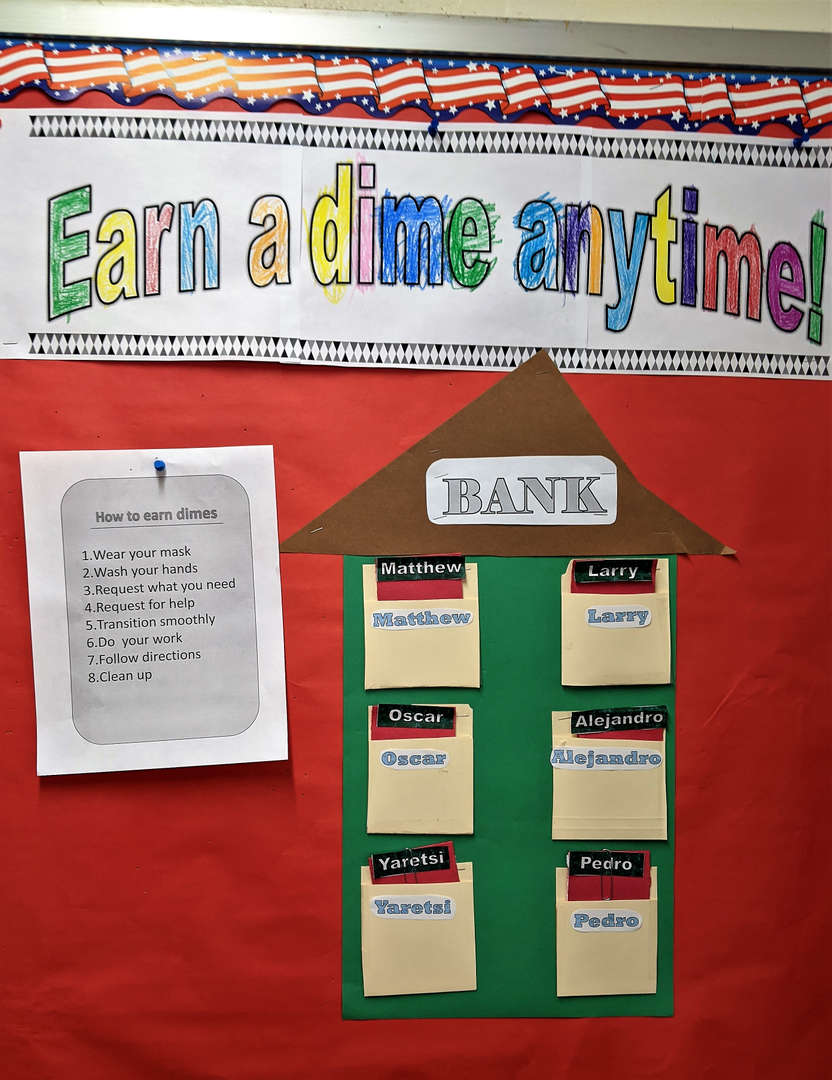 A billboard at St. Matt's explains how students can earn dimes for the store.