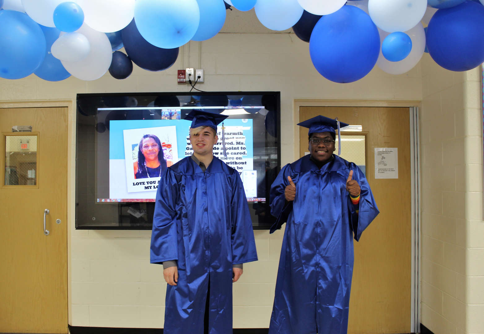 Class of 2021 graduates Patrick Kelly and Elliot Issaka pose for a photo.