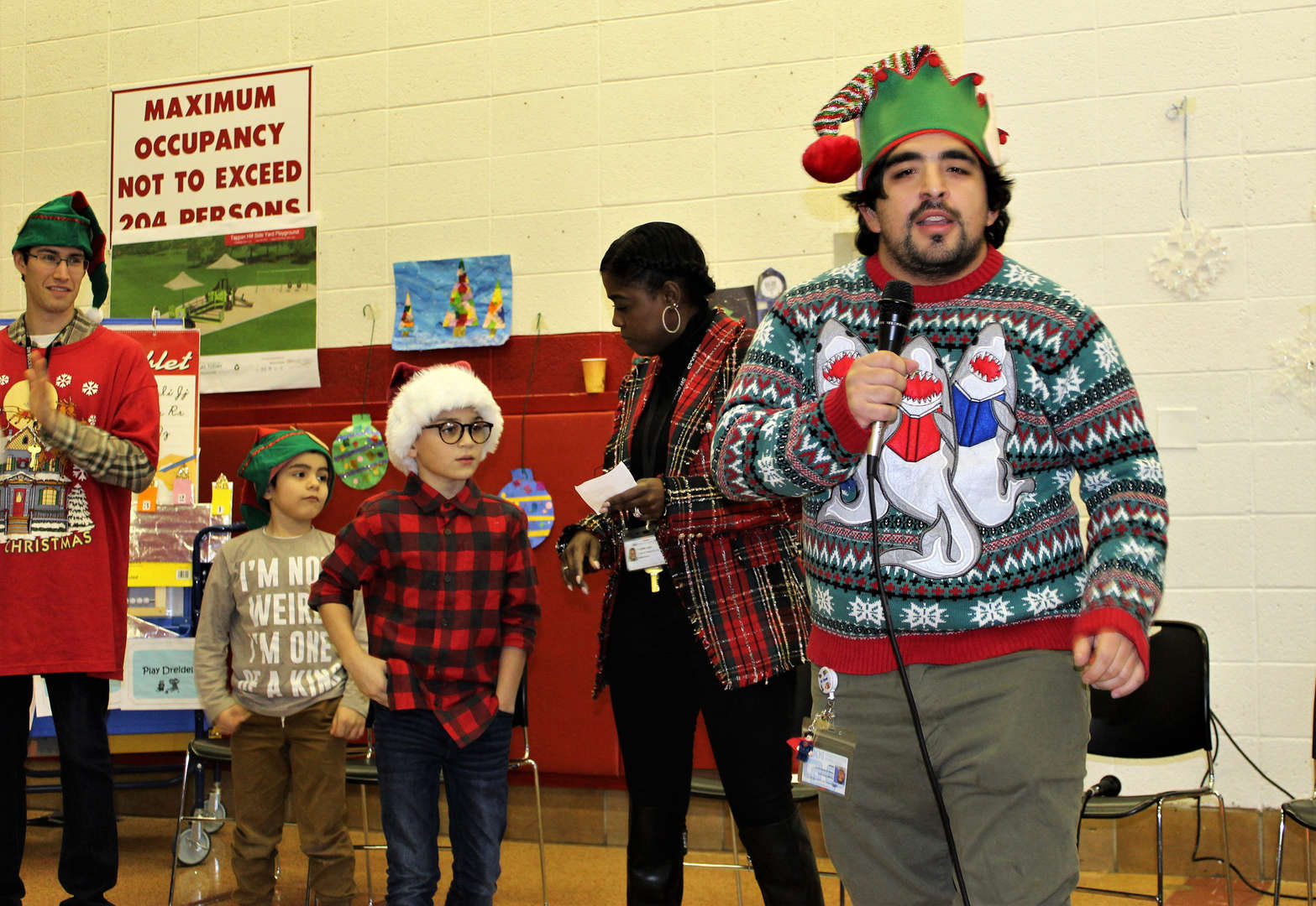 """Students and staff in one class sing """"Old North Pole"""" at the Tappan Hill School holiday concert."""