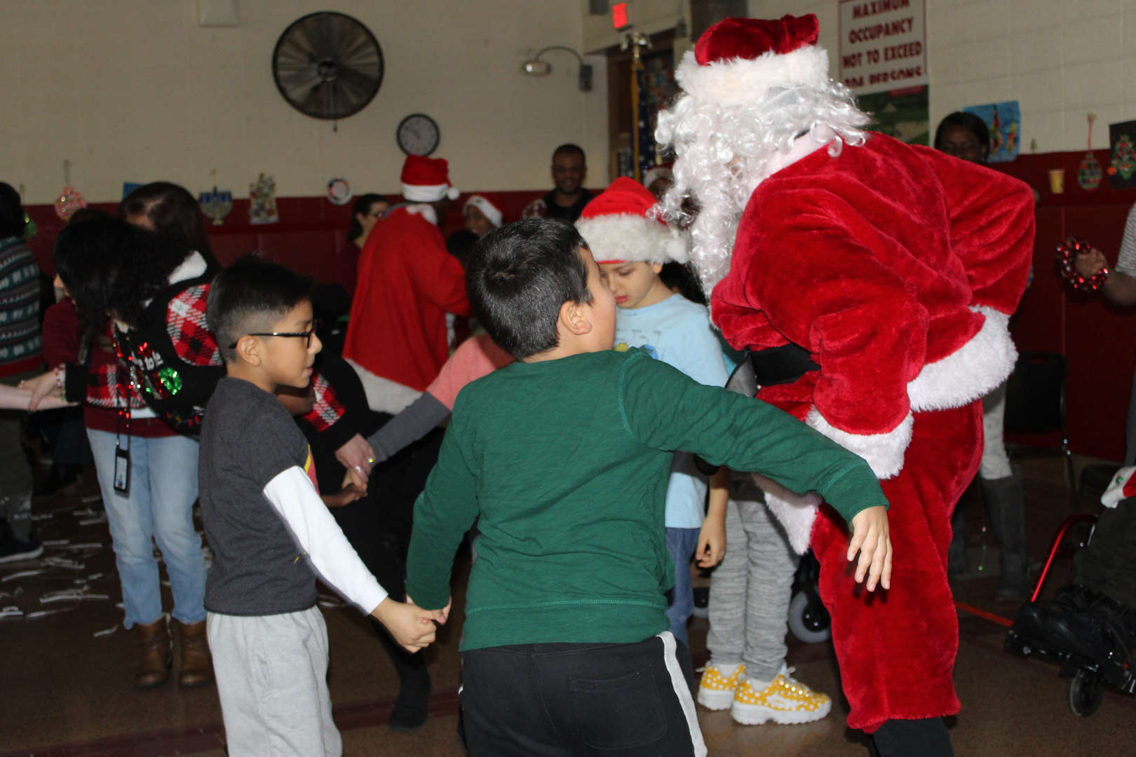 Students dance with Santa Claus at the Tappan Hill School holiday concert.