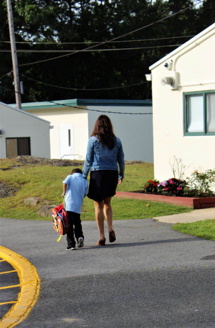 A teacher walking with a student.