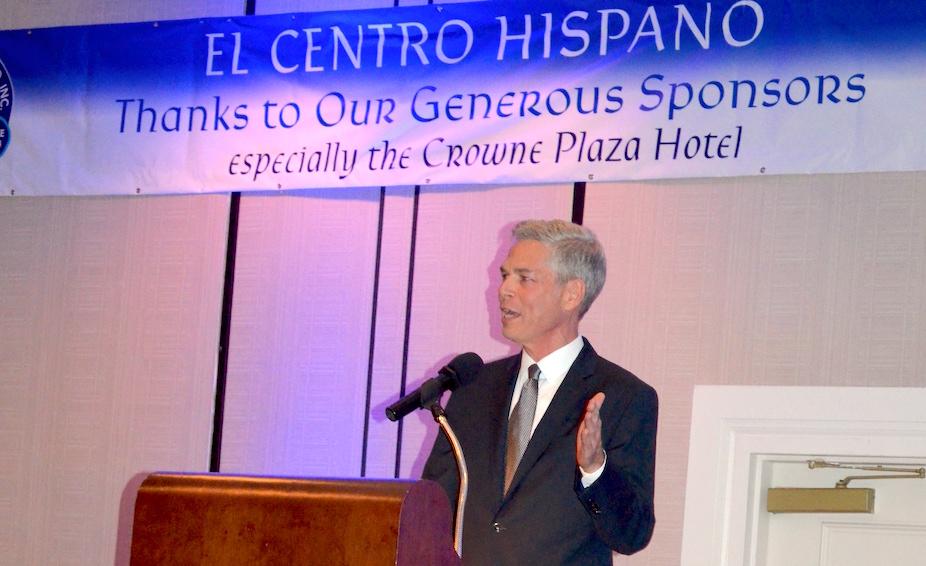 Speaker at podium at gala