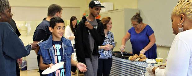 students and faculty enjoying breakfast during Spirit Week