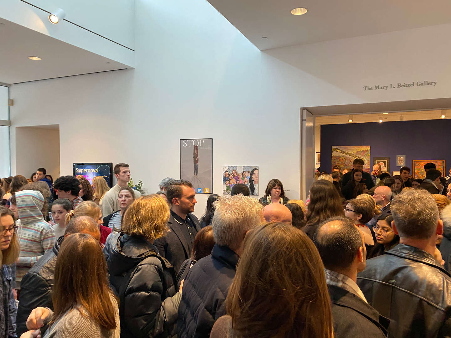 Crowd of art enthusiasts in gallery