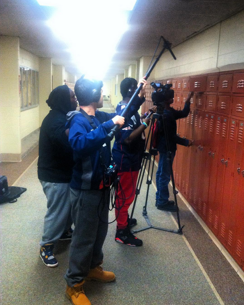 student film crew in the hallway during a production