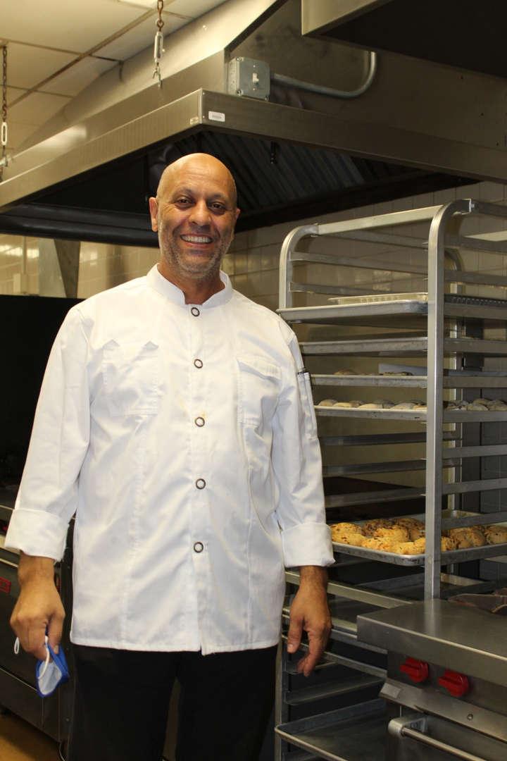 Man in chef whites in kitchen
