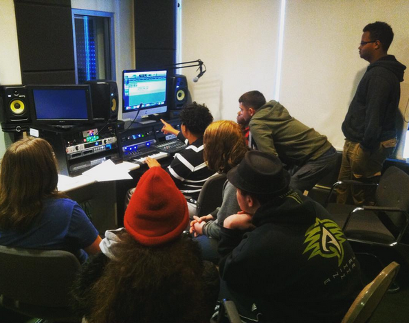 students in the studio working together on a project