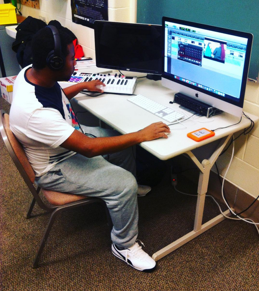 student using editing software to mix sound