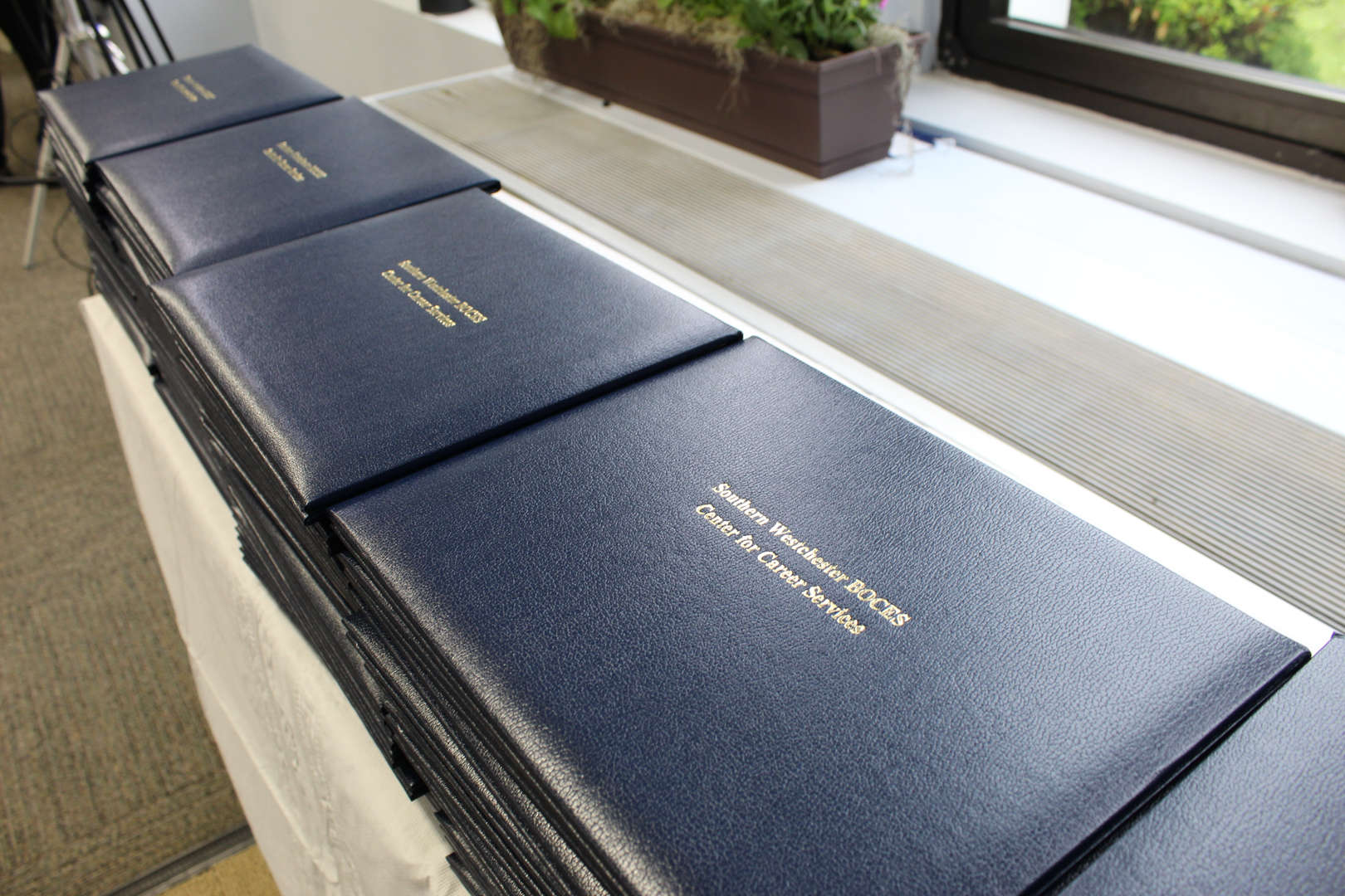 Row of diploma covers