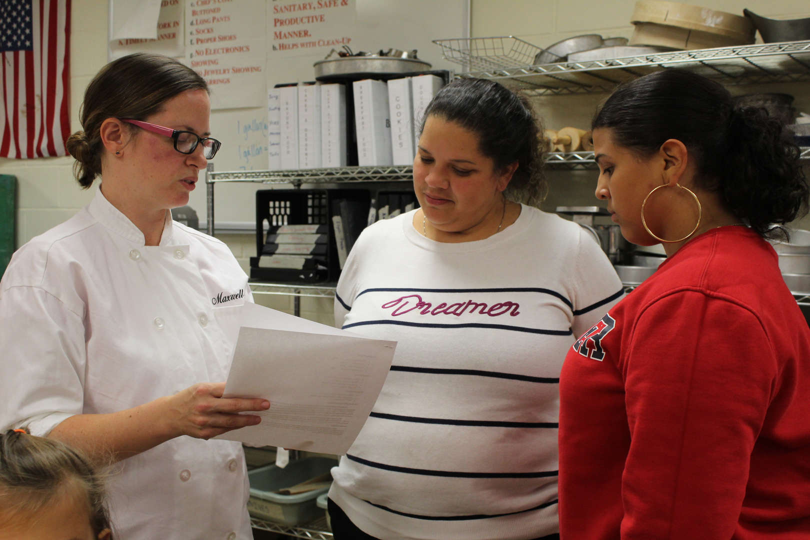 Chef speaks with mother and student