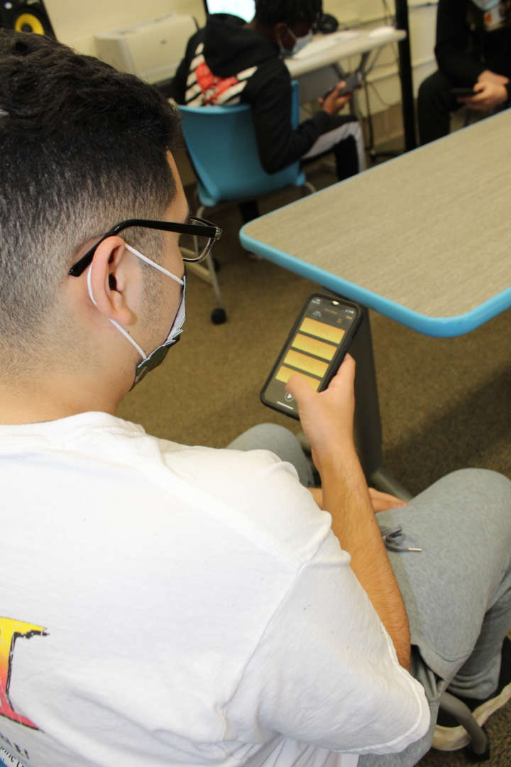 Student uses app to identify certain frequencies