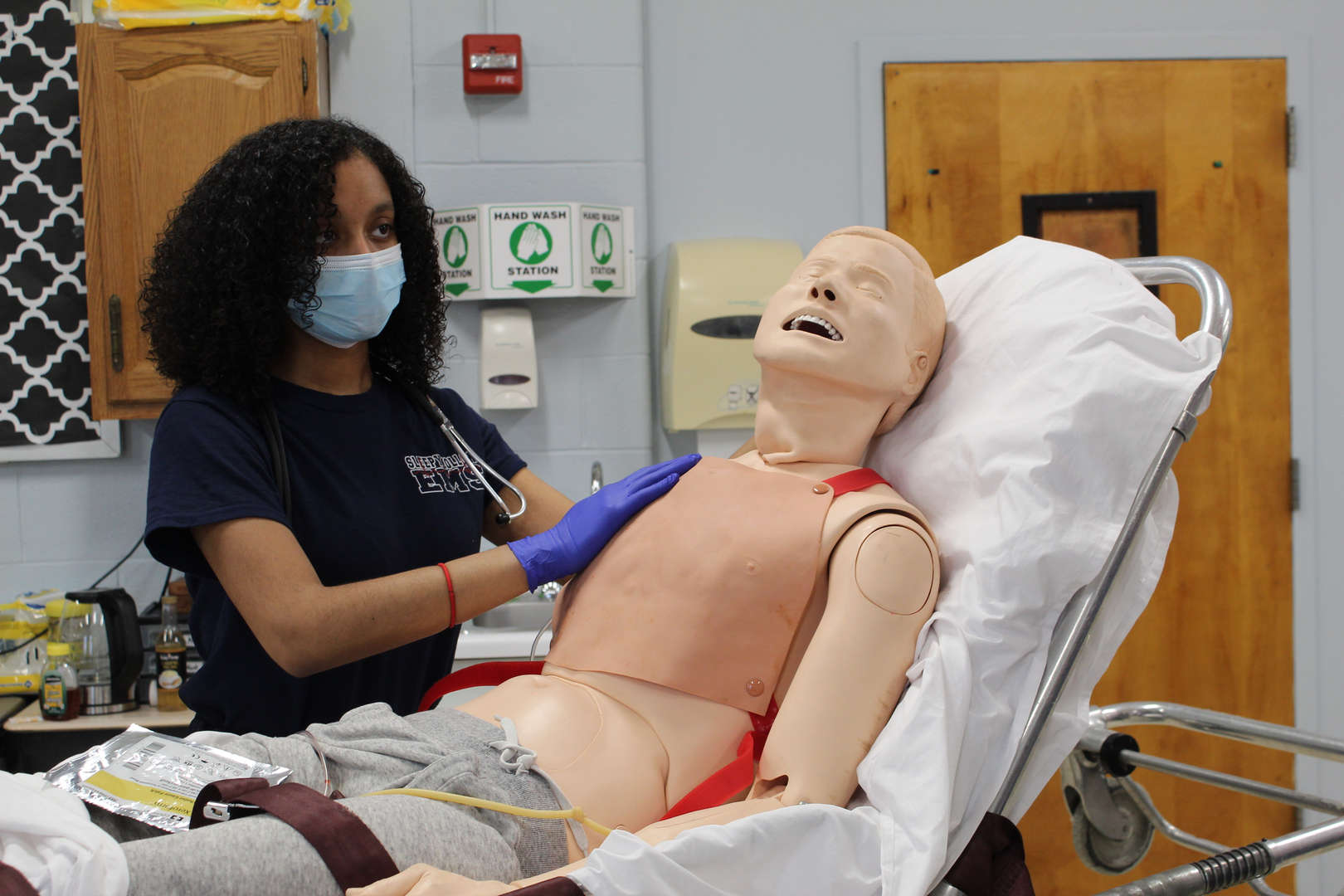 Student provides first aid to a dummy
