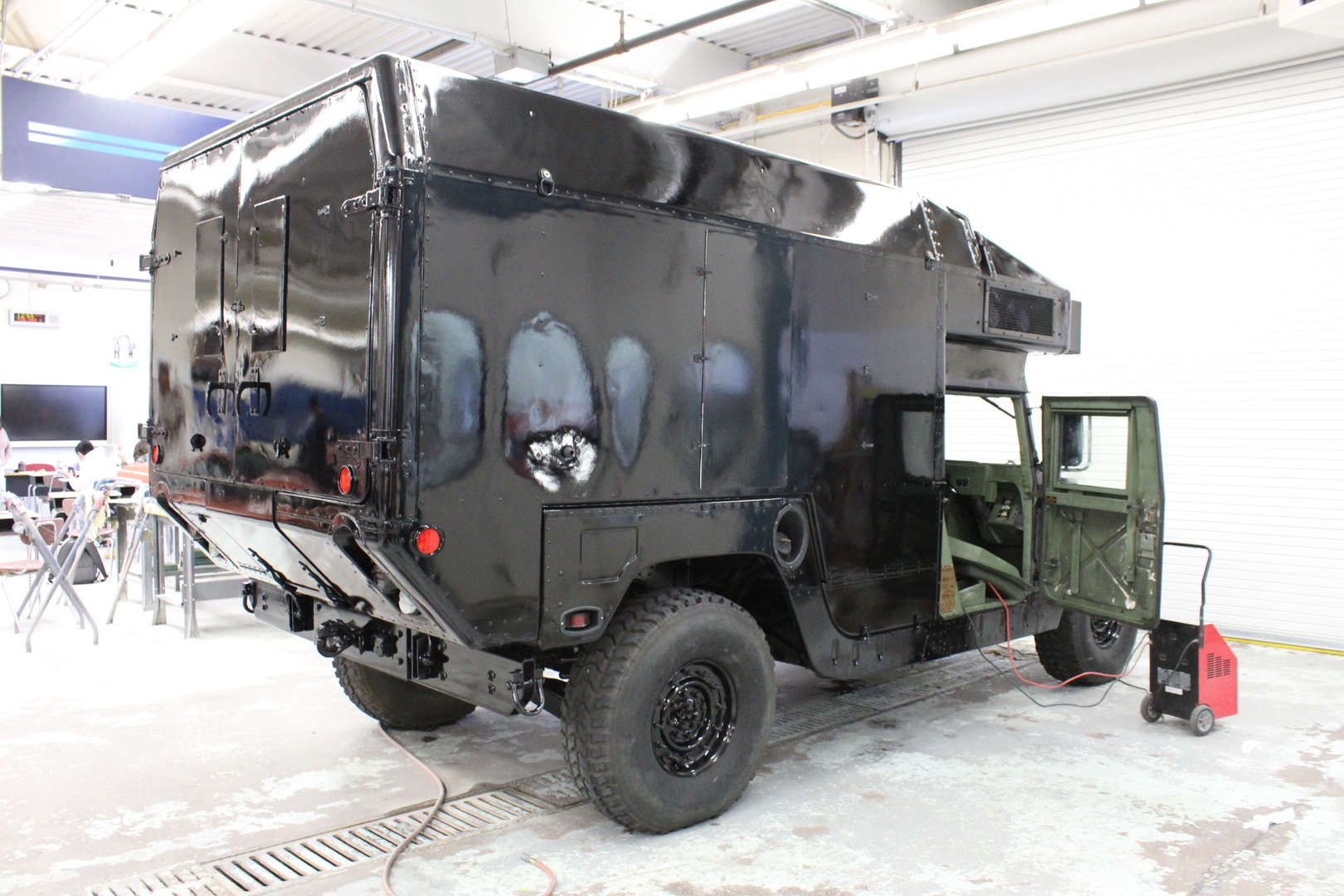 Humvee in garage
