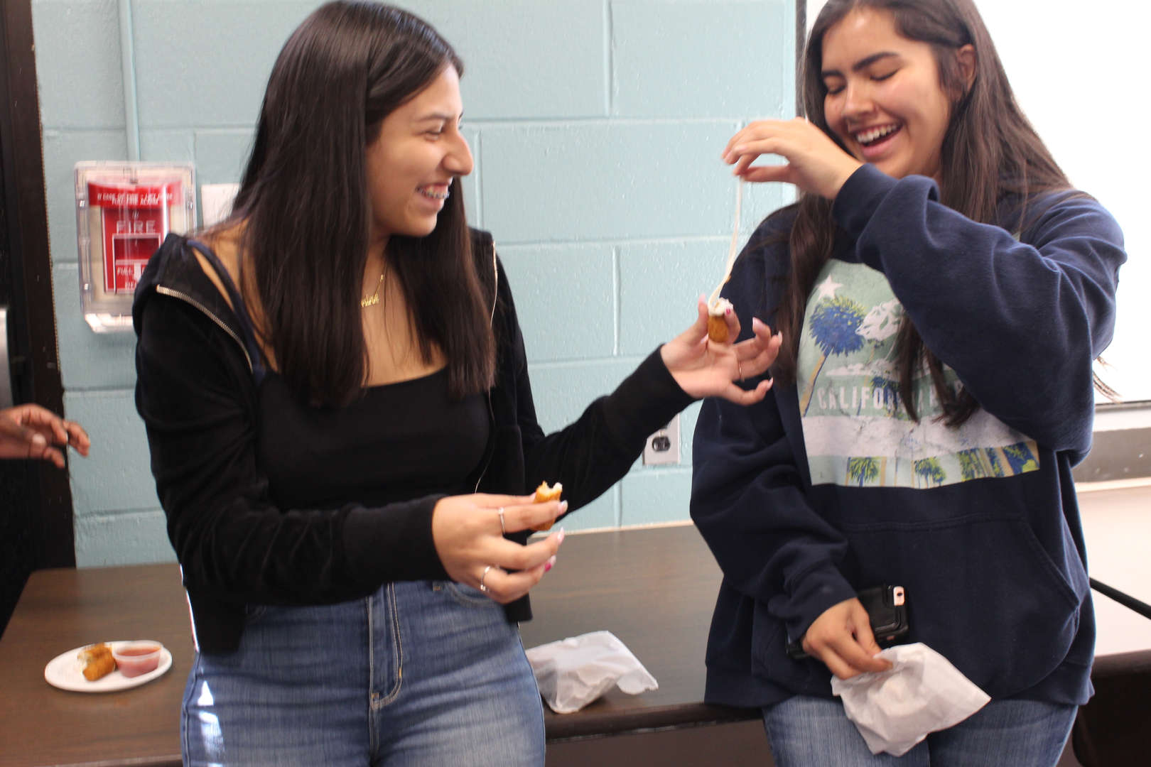 Students enjoy eating mozzarella sticks