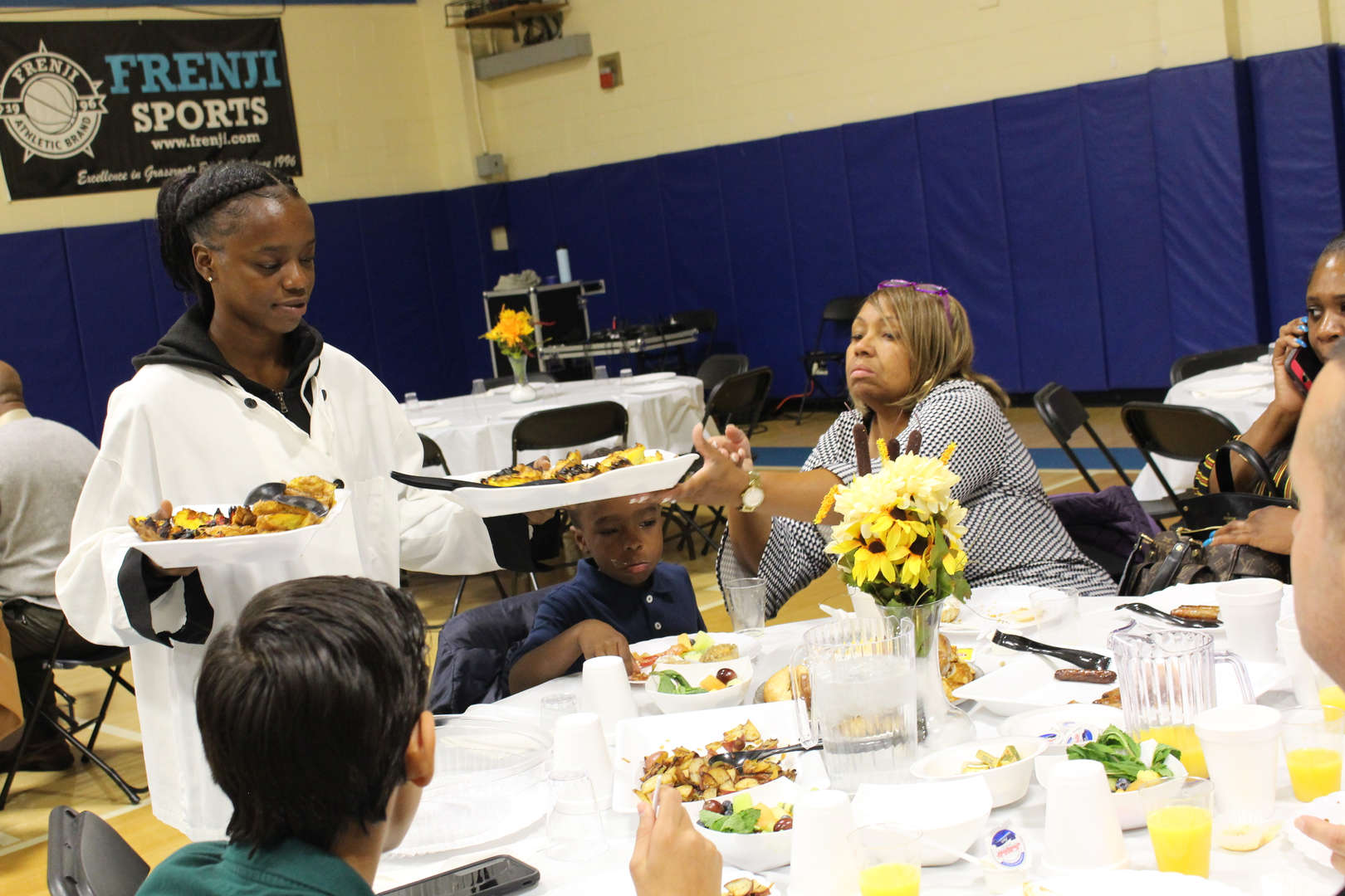 Student serves breakfast at community meal