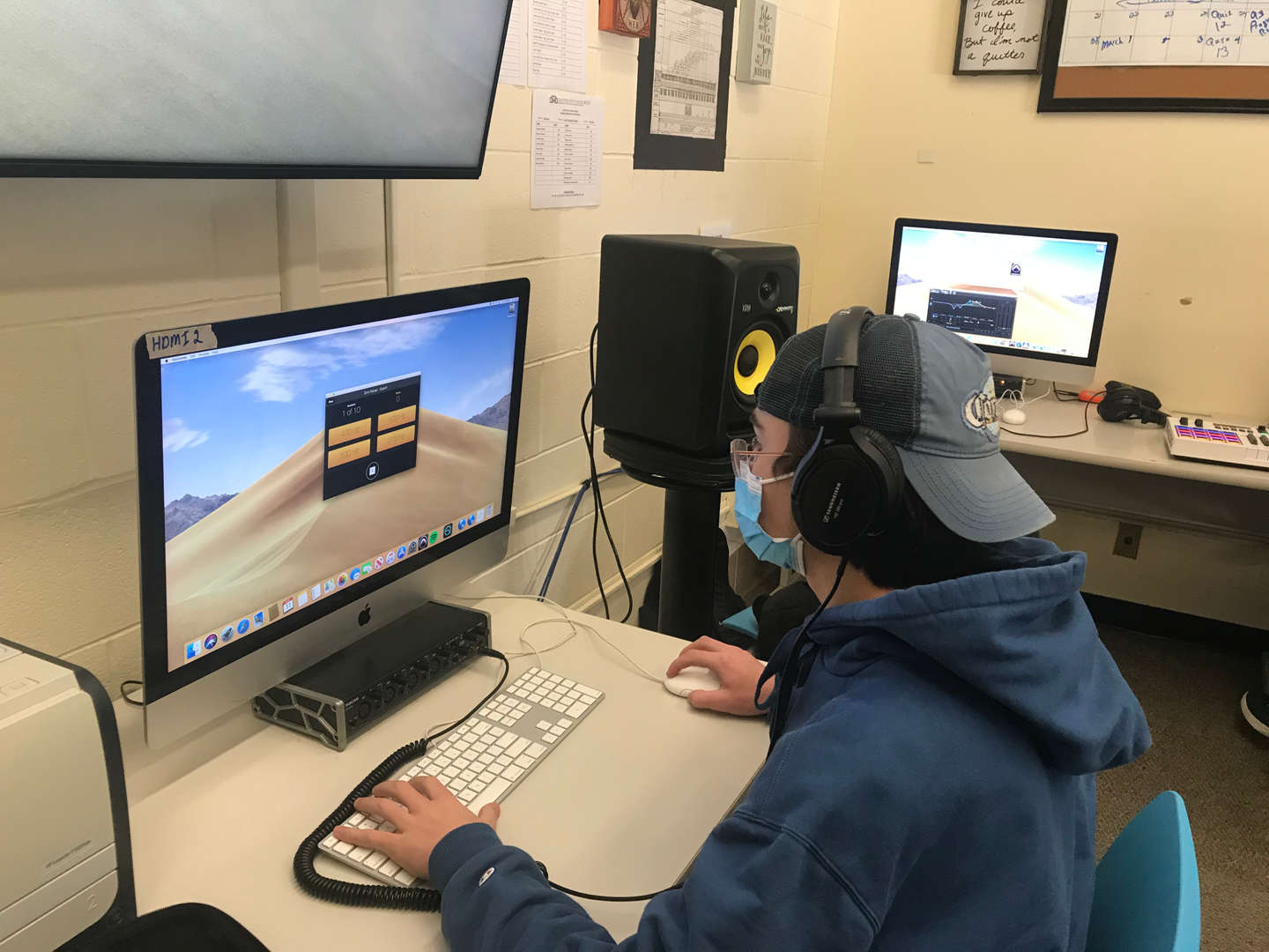 Student uses computer to listen to certain frequencies