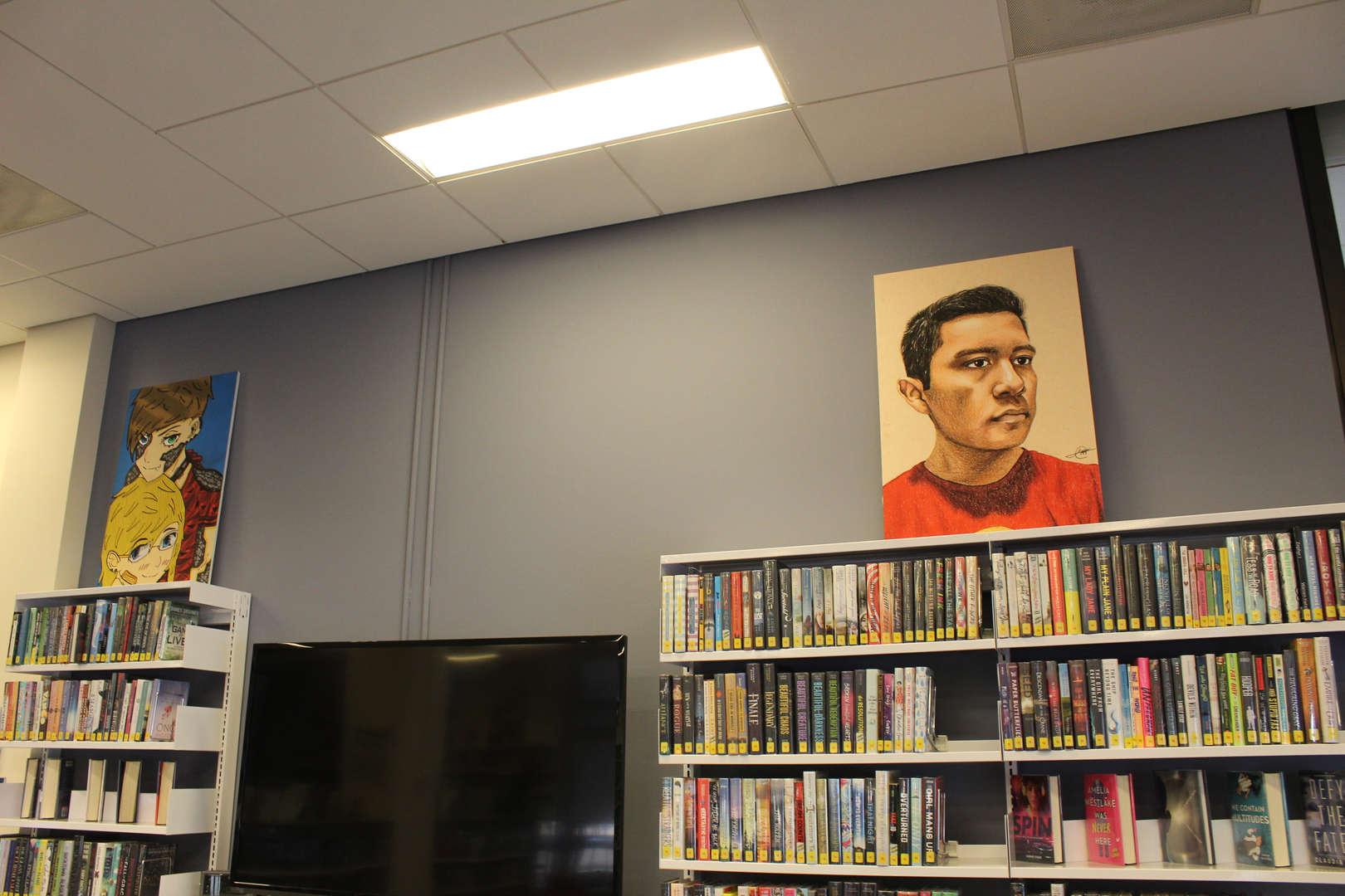 Art work on dipslay above library shelves