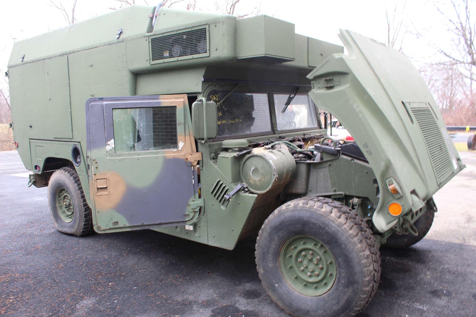 Military Humvee with its hood up