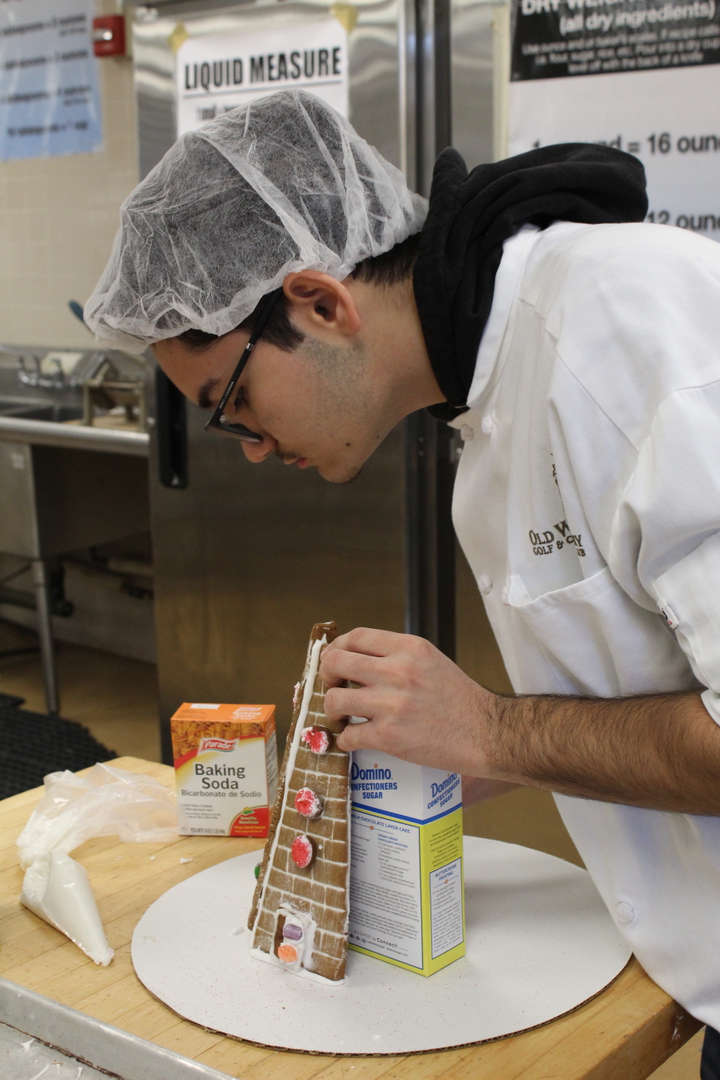 Student assembles gingerbread house