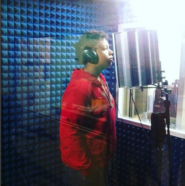 student in the sound booth recording audio
