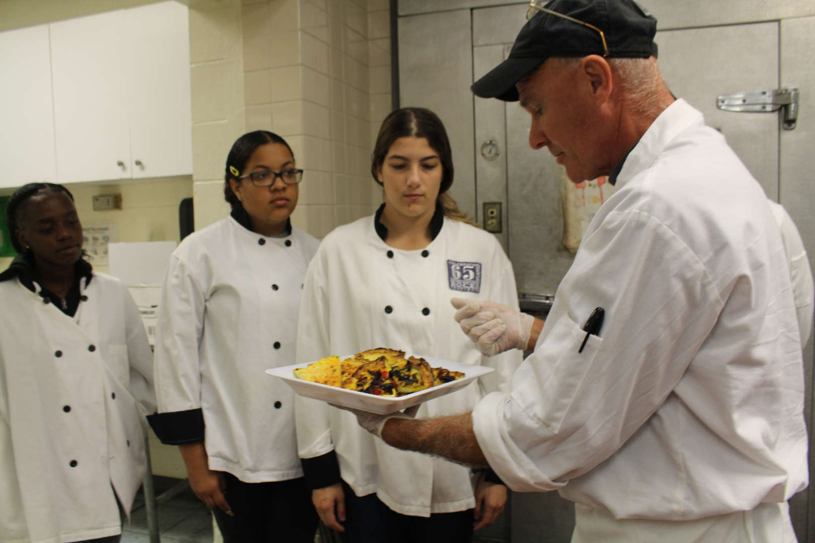 Chef instructs culinary students