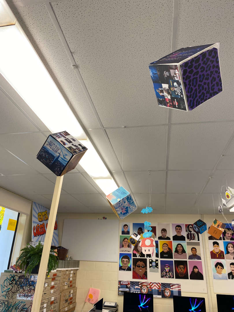 Cube art projects hang from the ceiling.