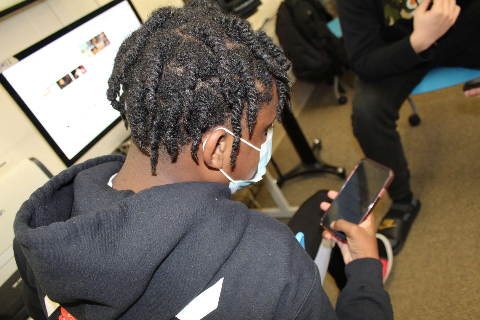 Student using app on smartphone