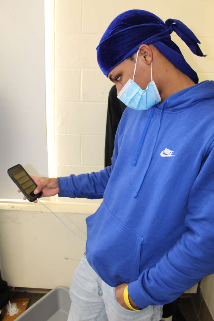 Student uses app on smartphone