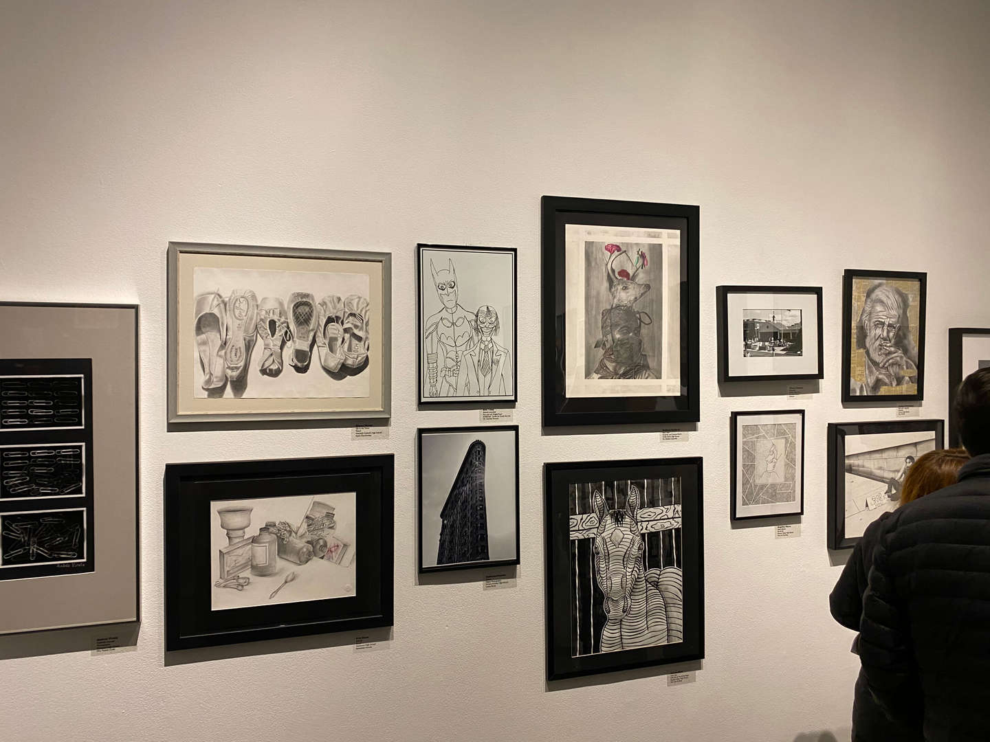 Black and white images hanging in gallery