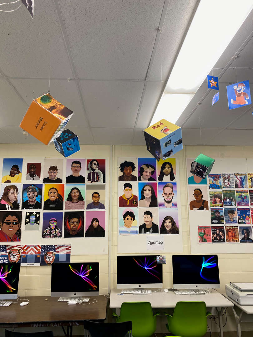 Cube art hanging from ceiling.