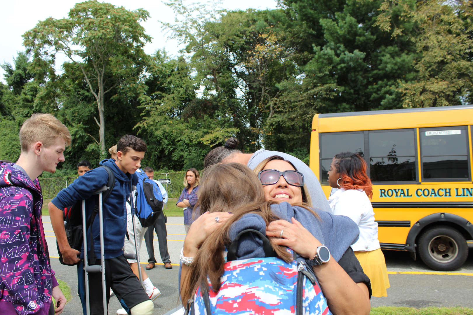 Student gets a hug from teacher