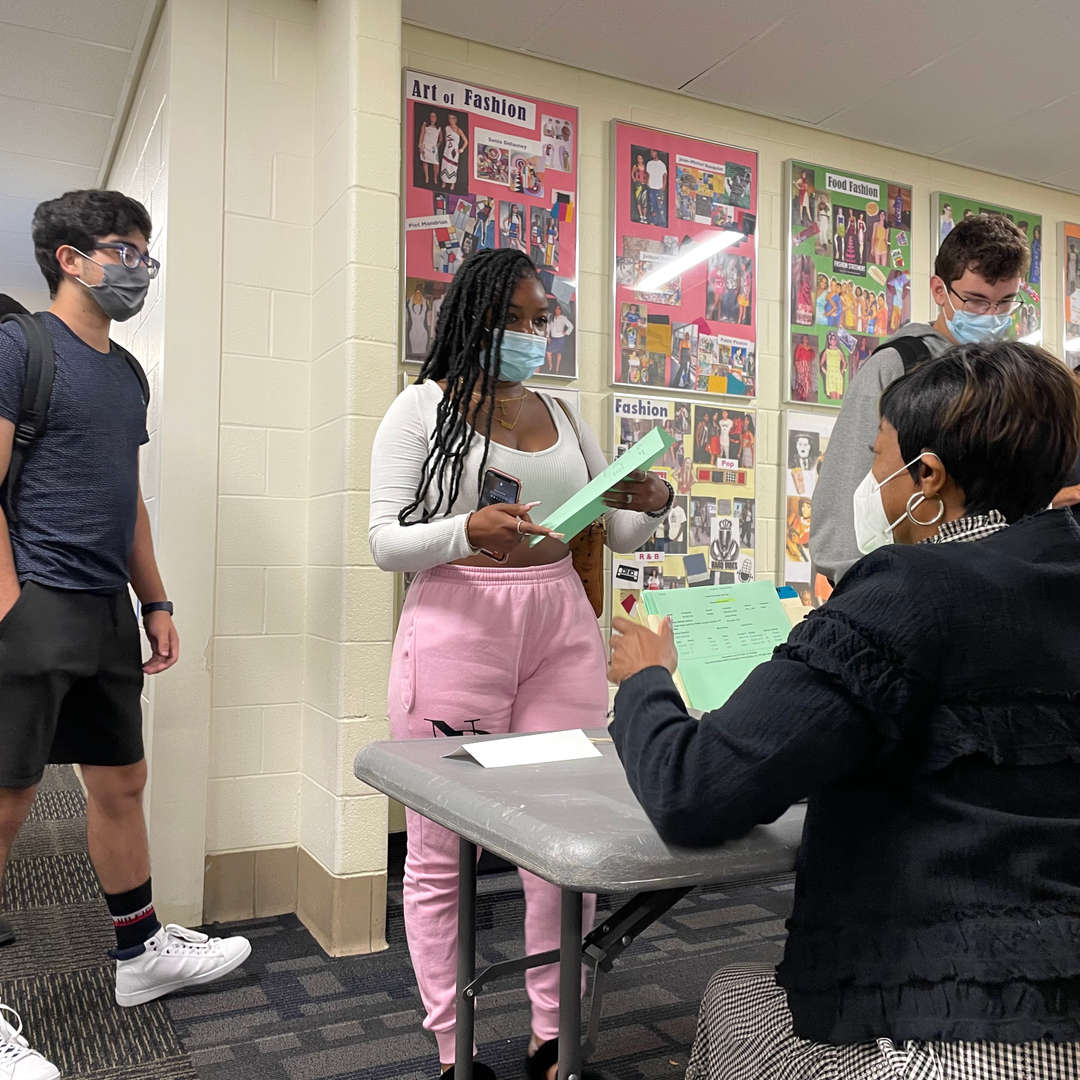 students check in with administrators