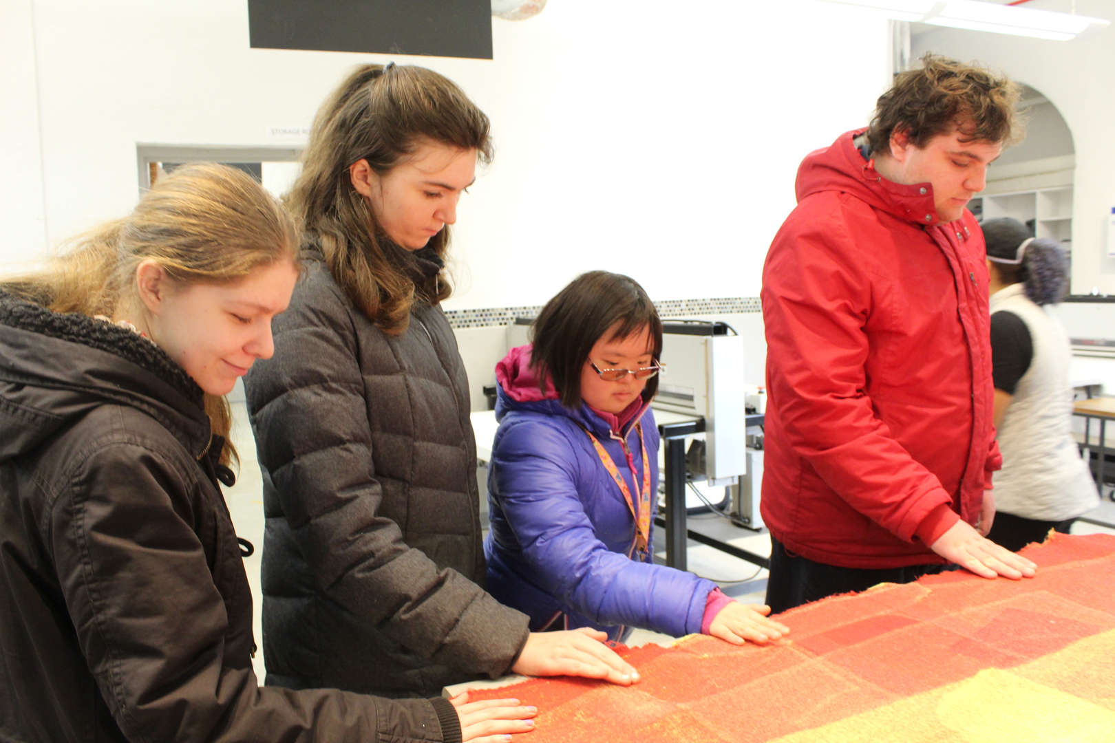 Students touch fabric