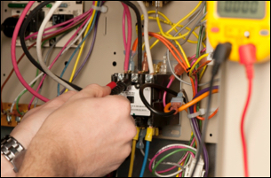 electrician testing and connecting wires