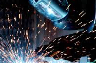 welder wearing mask while sparks fly