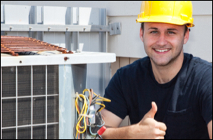HVAC technician giving thumbs up