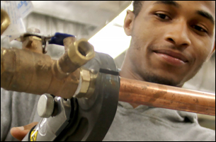 plumbing student at work