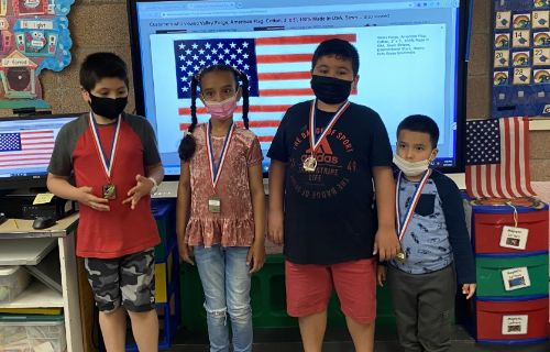 Four students wearing their medals.