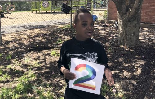 student outside holding 2